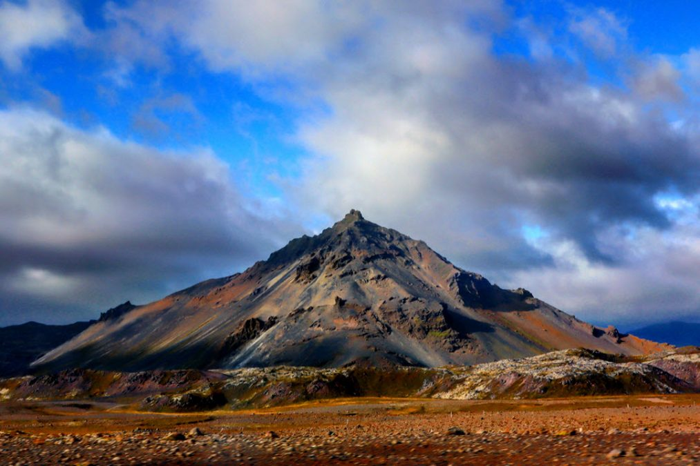 The Blue mountain standing alone across a rocky plain in Iceland