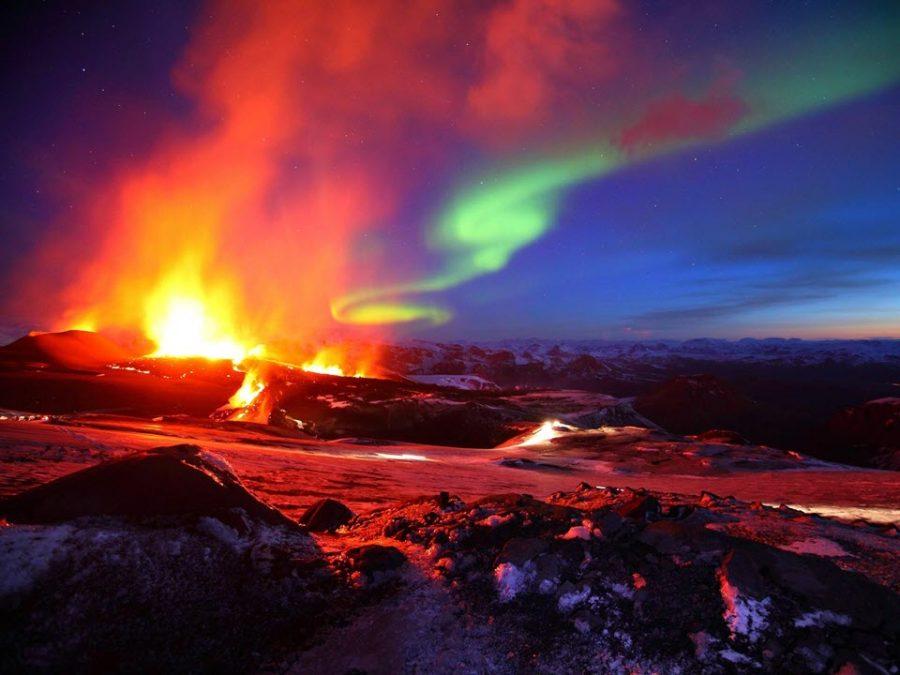 Lava eruption under the Aurora Borealis in Iceland